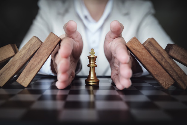 preventing-risk-playing-chess-business-board-business-insurance-concept_89286-109.jpg